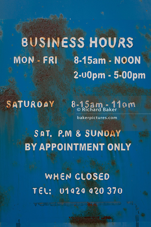 Detail of a rusting Business Hours sign, on 29th April 2017, at St Leonards, East Sussex, England.
