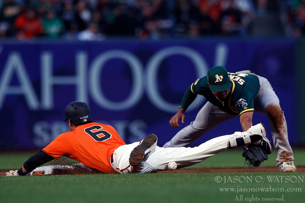 SAN FRANCISCO, CA - JULY 13: Steven Duggar #6 of the San Francisco Giants dives into second base for a double ahead of a tag from Marcus Semien #10 of the Oakland Athletics during the fourth inning at AT&T Park on July 13, 2018 in San Francisco, California. The San Francisco Giants defeated the Oakland Athletics 7-1. (Photo by Jason O. Watson/Getty Images) *** Local Caption *** Steven Duggar; Marcus Semien