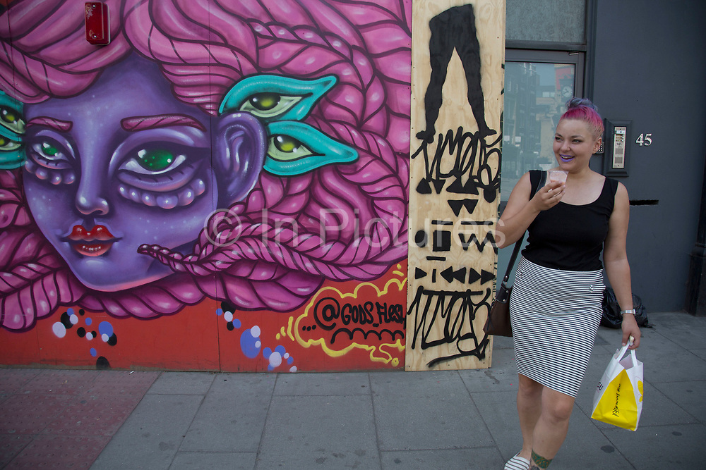 Street art by Amara Por Dios in Shoreditch, East London, United Kingdom. Street art in the East End of London is an ever changing visual enigma, as the artworks constantly change, as councils clean some walls or new works go up in place of others. While some consider this vandalism or graffiti, these artworks are very popular among local people and visitors alike, as a sense of poignancy remains in the work, many of which have subtle messages. (photo by Mike Kemp/In Pictures via Getty Images)
