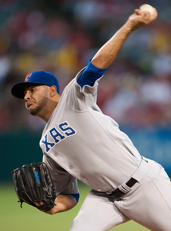 The Texas Rangers' Martin Perez pitches against the Angels at Angel Stadium on Wednesday.<br /> <br /> ///ADDITIONAL INFO:   <br /> <br /> angels.0721.kjs  ---  Photo by KEVIN SULLIVAN / Orange County Register  -- 7/20/16<br /> <br /> The Los Angeles Angels take on the Texas Rangers at Angel Stadium.