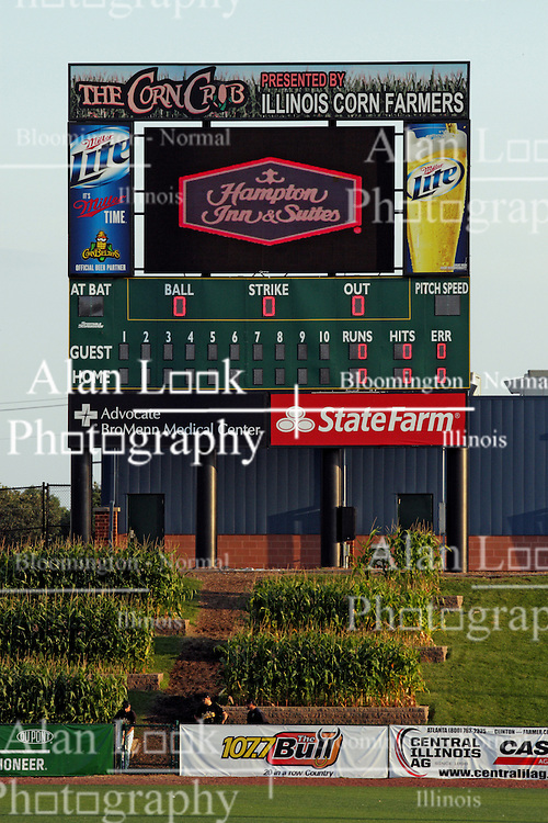 17 August 2013:  The golden mid evening sun drenches the cornstalks in center field under the scoreboard just before game time during a Frontier League Baseball game between the Rockford Aviators and the Normal CornBelters at Corn Crib Stadium on the campus of Heartland Community College in Normal Illinois