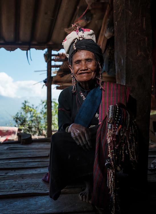 KYAING TONG, MYANMAR - CIRCA DECEMBER 2017: Portrait of family at the Pan Ian Village, Enn tribe also known as Eng or Black Teeth around Kyaing Tong