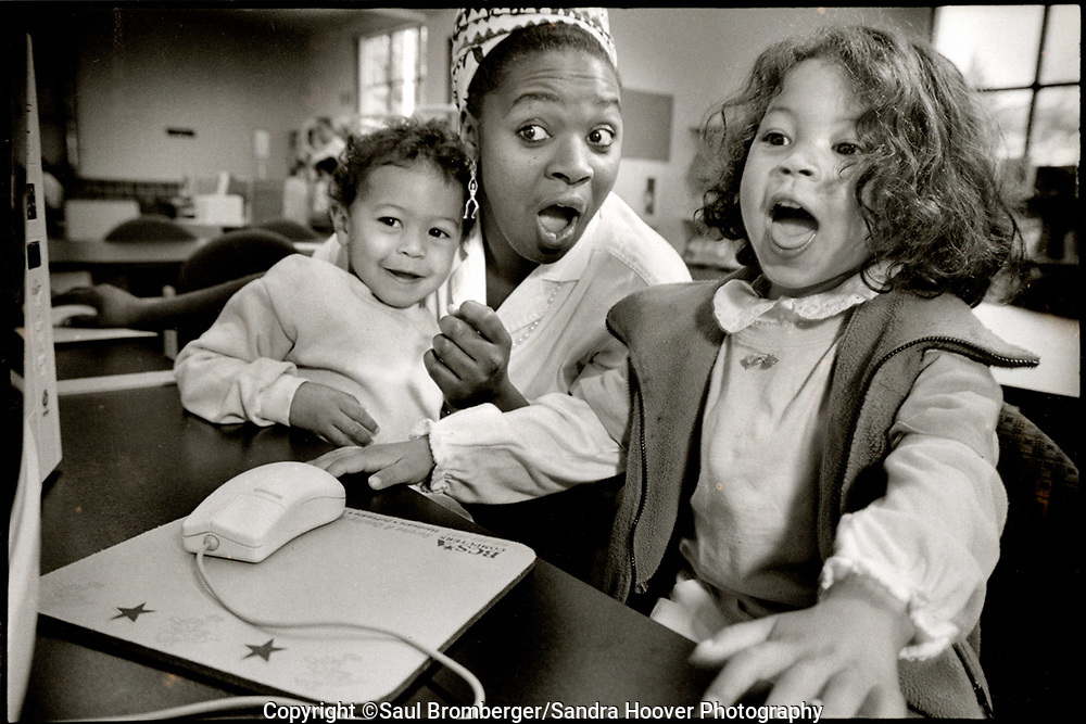 Client: Parenting Magazine - Cathomas Starbird with her 2 kids, Noble at left and Royal at right, working on an education program at the City of Marin public library.