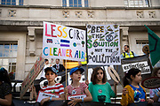 The Air that we Grieve march on July 12th 2019 in East London, United Kingdom. Organised by Extinction Rebellion to draw attention to air pollution and the climate emergency. Children in front of Hackney Town Hall where they held an assembly.