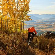 Malachi Artise rides the Ridge Trail at sunrise during peak autumn colors.