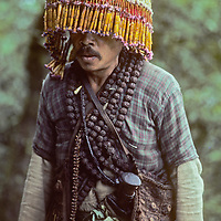 A Nepali jhankri (faith healer) treks to a meeting of his fellow practitioners in the Solo region of Nepal.