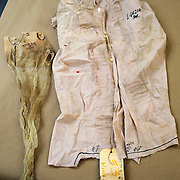 The blouse and a stocking worn by Irene Garza when her body was discovered in a canal on April 21, 1960, are displayed in the courtroom. The clothing she wore the last night she was alive, as well as several personal items found discarded throughout McAllen, were entered as evidence in the case against Feit. Nathan Lambrecht/The Monitor