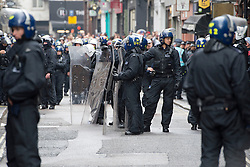 © London News Pictures. 11/06/2013. London, UK. POlice with riot shields.  Police waiting to raid a squat at abandoned police station on Beak Street, London which is being used by Anti-G8 activists as their headquarters ahead of a demonstration in central London today (Tues) The G8 Summit is due to take place in Norther Ireland early next week.  Photo credit: Ben Cawthra/LNP