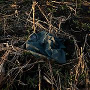 SNIZHNE, UKRAINE - OCTOBER 17, 2014: Part of an Ukrainian army uniform is seen among a destroyed crop field outside Petrovskiy village in Donetsk region. CREDIT: Paulo Nunes dos Santos