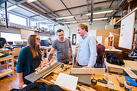 Students collaborating in the cabinetmaking department of the school.