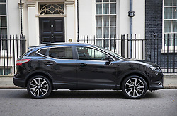 © Licensed to London News Pictures. 14/10/2016. London, UK. Nissan Chairman and CEO Carlos Ghosn arrives in Downing in a Nissan Qasqai car for talks with Prime Minister Theresa May. Mr Ghosn ha stated that he would like a government pledge to  compensate Nissan for any tariffs that may be imposed after the UK leaves the EU. Photo credit: Peter Macdiarmid/LNP