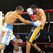 """Kanat """"QazaQ"""" Islam of Almaty, Kazakhstan (L) punches Noroberto """"Demonio"""" Gonzalez of Monterrey, Mexico to win the NABO Jr. Middle Weight Title in a 12 round unanimous decision during a Nelsons Promotions boxing match at the Boca Raton Resort  and Club on Friday, May 26, 2017 in Boca Raton, Florida.  (Alex Menendez via AP)"""