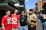 2/2/13 New Orleans LA.-NFL  The Day before the Super Bowl XLV11Michael Vukelich 82 yrs old, right, poses with his son Mike and his two Grandsons Max and Mark on Bourbon Street. Michael Vukelich has been to 599 NFL games, all 5 San Francisco SUper Bowls and is attending Sundays Super Bowl XLV11 in New Orleans it will be his 600th game and his 6th SF 49er's Super Bowl. Photo©Suzi Altman