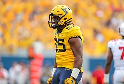 Sep 14, 2019; Morgantown, WV, USA; West Virginia Mountaineers defensive lineman Dante Stills (55) celebrates after a tackle during the first quarter against the North Carolina State Wolfpack at Mountaineer Field at Milan Puskar Stadium. Mandatory Credit: Ben Queen-USA TODAY Sports