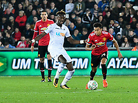 Football - 2017 / 2017 EFL (League) Cup - Fourth Round: Swansea City vs. Manchester United<br /> <br /> Jesse Lingard of Manchester United attacks chased by Tammy Abraham of Swansea City, at The Liberty Stadium.<br /> <br /> COLORSPORT/WINSTON BYNORTH