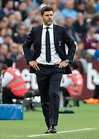 Football - 2018 / 2019 Premier League - West Ham United vs. Tottenham Hotspur<br /> <br /> A disgruntled looking Mauricio Pochettino, Manager of Tottenham FC, at the London Stadium<br /> <br /> COLORSPORT/DANIEL BEARHAM