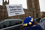 Anti Brexit pro Europe demonstrators protest waving European Union and Union Jack flags and placards in Westminster opposite Parliament on the as five days of Brexit debate begins on 4th December 2018 in London, England, United Kingdom.