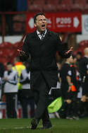 Derby County head coach Darren Wassall applauding the Derby county support .Skybet football league championship match, Brentford  v Derby county at Griffin Park in London on Saturday 20th February 2016.<br /> pic by Steffan Bowen, Andrew Orchard sports photography.