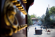 Some pilgrims pray at the Yonghe Temple (Chinese 雍和宮, pinyin Yōng hé gōng), also known as the Lama Temple in Beijing, China, August 15, 2014.<br /> <br /> Confucianism, Taoism and Buddhism are the three major religions in China. Temples and statues witness their ancient roots all over the Chinese country.<br /> <br /> © Giorgio Perottino