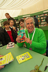 © Licensed to London News Pictures. 22/05/2014. Hay-on-Wye, UK. Henry Winkler signs books for children on the first day of the festival. The Hay Festival of Literature and Arts celebrates its 27th year in Wales. Photo credit : Graham M. Lawrence/LNP