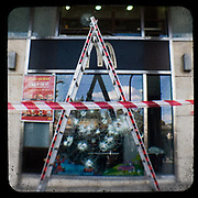 A smashed window in the McDonald's restaurant on Syntagma Square. <br /> <br /> Following the murder of a 15 year old boy, Alexandros Grigoropoulos, by a policeman on 6 December 2008 widespread riots, protests and unrest followed lasting for several weeks and spreading beyond the capital and even overseas<br /> <br /> When I walked in the streets of my town the day after the riots I instantly forgot the image I had about Athens, that of a bustling, peaceful, energetic metropolis and in my mind came the old photographs from WWII, the civil war and the students uprising against the dictatorship. <br /> <br /> Thus I decided not to turn my digital camera straight to the destroyed buildings but to photograph through an old camera that worked as a filter, a barrier between me and the city.