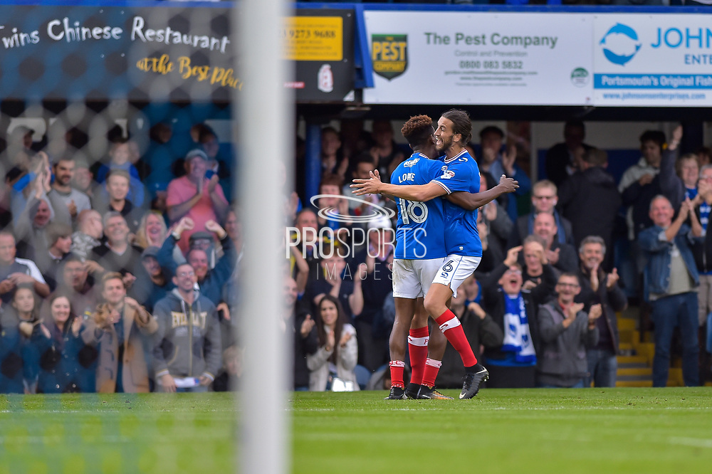 Portsmouth Forward, Jamal Lowe (18) scores his 2nd goal to make it 3-1 and celebrates with Portsmouth Defender, Christian Burgess (6) during the EFL Sky Bet League 1 match between Portsmouth and Fleetwood Town at Fratton Park, Portsmouth, England on 16 September 2017. Photo by Adam Rivers.