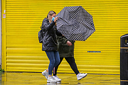 © Licensed to London News Pictures. 02/10/2020. London, UK. A woman struggles to control her umbrella in north London as Storm Alex arrives from Europe. The Met Office forecasts heavy rain and windy weather for the next few days in the capital, caused by Storm Alex. Photo credit: Dinendra Haria/LNP