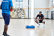 DUBLIN, IRELAND - August 13, 2018: Aidan & his best friend/trainer Cody Giles put in an intense workout session at the Dublin Lions training facility.<br /> <br /> Aidan Harris-Igiehon was born in Ireland. Aidan moved to the United States at the age of 12 to pursue his dreams of becoming a professional basketball player. Growing up in Ireland, basketball is not a traditional sport in the country so once Aidan saw some promise and potential he knew that moving to America was his only option. At the age of 12 Aidan had already outgrown his classmates and even dunked his first basketball in middle school. He had to leave his mother in Ireland and went on to live with his Aunt and Uncle in Brooklyn, NY where he would being to start a new life and pursue basketball. <br /> <br /> Aidan had went on to refine his skills and continue to grow - 6'10 240 pounder by the time he was a junior at Lawrence Woodmere Academy in New York. He became a top 50 National prospect and sought after by colleges across the country. This is Aidan's first time seeing his family and friends in 2 years and the first back home since all of the national recognition. Ireland had scheduled a week long of camps and exhibitions that would be featuring Aidan.<br /> <br /> Photo by: Johnnie Izquierdo