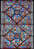 Medieval Windows of the Gothic Cathedral of Chartres, France- dedicated to Joseph the Patriach .  Bottom central panel - bottom Joseph dreams the sun, moon and stars make obeisance to him (Gen.37:9)?left - Jacob sends Joseph to Shechem to take supplies to his brothers, right - Joseph's brothers tending their flocks in Dothan (Gen.37:18) , top - Joseph's brothers lower him into an old well (Gen.37:24) . Top central panel - bottom Angry that Joseph spurned her, Potiphar's wife accuses him of attempted rape , left - Convinced by his wife's calumny, Potiphar has Joseph arrested , right - Joseph is thrown into prison , top - Pharaoh asleep in his palace, dreaming . A UNESCO World Heritage Site.. .<br /> <br /> Visit our MEDIEVAL ART PHOTO COLLECTIONS for more   photos  to download or buy as prints https://funkystock.photoshelter.com/gallery-collection/Medieval-Middle-Ages-Art-Artefacts-Antiquities-Pictures-Images-of/C0000YpKXiAHnG2k