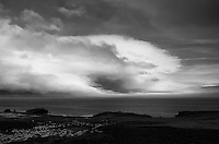 Storm Clouds and Fog Bank Along the East Coast of Iceland. Image taken with a Leica X2 camera (ISO 100, 24 mm, f/5, 1/500 sec). Raw image converted to B&W with Nik Silver Efex Pro.