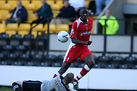 Photo: Pete Lorence.<br />Notts County v Swindon Town. Coca Cola League 2. 23/09/2006.<br />Fola Onibuje sends the ball past Kevin Pilkington to score Swindon's only goal of the match.