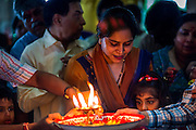 """15 SEPTEMBER 2013 - BANGKOK, THAILAND: Hindus in Bangkok pray on the last day of Ganesha Chaturthi celebrations at Shiva Temple in Bangkok. Ganesha Chaturthi is the Hindu festival celebrated on the day of the re-birth of Lord Ganesha, the son of Shiva and Parvati. The festival, also known as Ganeshotsav (""""Festival of Ganesha"""") is observed in the Hindu calendar month of Bhaadrapada. The festival lasts for 10 days, ending on Anant Chaturdashi. Ganesha is a widely worshipped Hindu deity and is revered by many Thai Buddhists. Ganesha is widely revered as the remover of obstacles, the patron of arts and sciences and the deva of intellect and wisdom. The last day of the festival is marked by the immersion of the deity, which symbolizes the cycle of creation and dissolution in nature. In Bangkok, the deity (statue) was submerged in the Chao Phraya River.     PHOTO BY JACK KURTZ"""