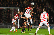 Matty Blair of Doncaster Rovers (17) heads the ball above a crowd of players during the EFL Sky Bet League 1 match between Doncaster Rovers and Sunderland at the Keepmoat Stadium, Doncaster, England on 23 October 2018.