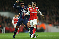 Thiago Silva of Paris Saint-Germain tackles Aaron Ramsey of Arsenal (r) . UEFA Champions league group A match, Arsenal v Paris Saint Germain at the Emirates Stadium in London on Wednesday 23rd November 2016.<br /> pic by John Patrick Fletcher, Andrew Orchard sports photography.