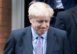 © Licensed to London News Pictures. 18/06/2019. London, UK. Conservative Party leadership favourite Boris Johnson leaves a house near Parliament to head to the BBC leaders debate. Boris has cemented his position as favourite to become the next Prime Minster after winning a clear majority in the second round of the conservative party's leadership race. Photo credit: Peter Macdiarmid/LNP