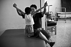Li Yaohua, 5, is seen with his father Li Qingsong at Limb and Maim Center in Chengdu, Sichuan in China.