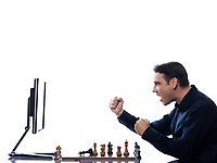 caucasian man playing chess with computer concept on isolated white background