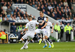 Ben White of Leeds United makes a clearance under prssure from Jed Wallace of Millwall - Mandatory by-line: Arron Gent/JMP - 05/10/2019 - FOOTBALL - The Den - London, England - Millwall v Leeds United - Sky Bet Championship
