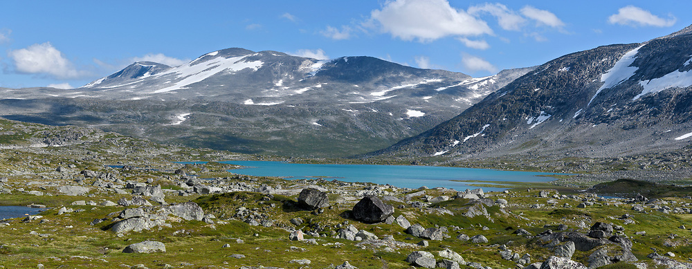 A mountain ridge and lake at Strynefjellet (about 1200-1500 m elevation) on the border between Stryn and Skjåk municipality, western Norway.