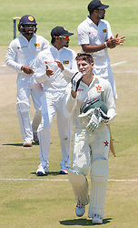 Zimbabwe batsman Peter Moor leaves the pitch after a tough morning session during the third day of the 100th test match for Zimbabwe played in a series of two matches with Sri Lanka at Harare Sports Club 31 October 2016.