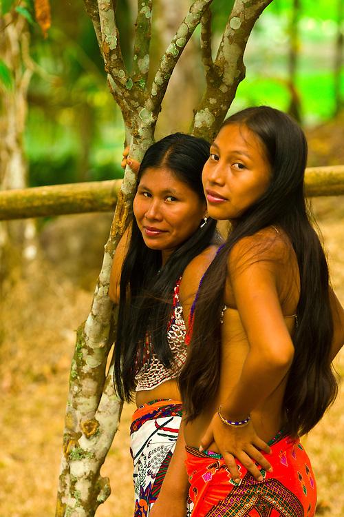 Embera Indian women in their village at Ellapuru, Chagres River, Soberania National Park (near the Panama Canal), Panama