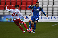 Stevenage midfielder Tom Pett (26)  and Carlisle United defender Joe Riley (7) battles for possession during the EFL Sky Bet League 2 match between Stevenage and Carlisle United at the Lamex Stadium, Stevenage, England on 20 March 2021.