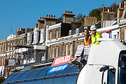 Two activists from Insulate Britain have glued themselves to the top of a lorry at the entrance to the port of Dover on the 24th of September 2021 in Dover, United Kingdom. Over 40 activists from Insulate Britain blocked the road with some gluing themselves to the carriageway of the A20 at the Eastern docks roundabout. There are blocking the roads to highlight that fuel poverty is killing people in Dover and across the UK.