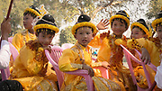 Boys during A Novitiation Parade, wearing traditional clothes, Mandalay, Myanmar<br /> A formal Novitiation ceremony involves a parade around the pagodas on the first day with the boys all dressed up as princes.