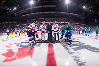 REGINA, SK - MAY 23: Jason Bernard of Sherwin-Williams, Angel Taypotat of the Royal Canadian Legion Branch 001, Commanding Officer, Lieutenant Jay MacKeen of the PPCLI 2nd Battalion and Kurt and Claude Wickenheiser on behalf of brother Dale Wickenheiser stand at centre ice for the ceremonial puck drop between Sam Steel #23 of the Regina Pats and Glenn Gawdin #15 of the Swift Current Broncos at the Brandt Centre on May 23, 2018 in Regina, Canada. (Photo by Marissa Baecker/CHL Images)