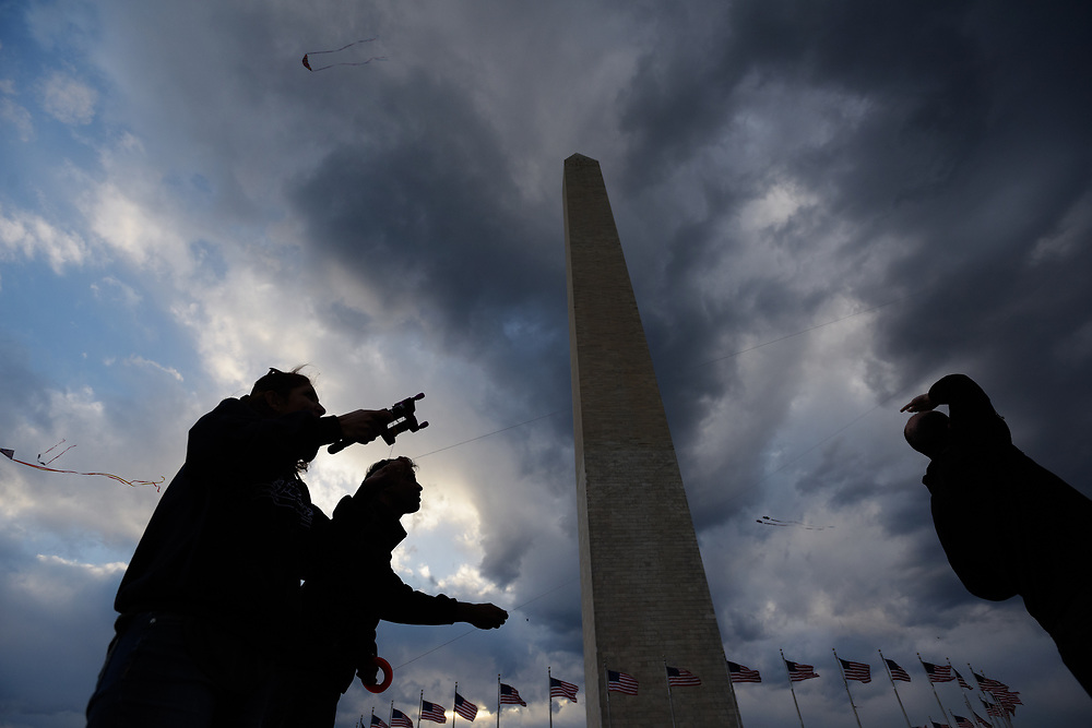 The Washington Monument towers over kite flyers during the kite festival on the National Mall as part of the National Cherry Blossom Festival. April, 02, 2016 in Washington, DC.