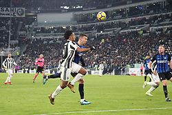December 9, 2017 - Turin, Piedmont, Italy - Juan Cuadrado (Juventus FC) and Ivan Perisic (FC Internazionale) compete for the ball during the Serie A football match between Juventus FC and FC Internazionale at Allianz Stadium on 09 December, 2017 in Turin, Italy..The final score is 0-0. (Credit Image: © Massimiliano Ferraro/NurPhoto via ZUMA Press)