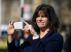 © Licensed to London News Pictures. 29/03/2019. London, UK. CLAIRE PERRY MP is seen watching protestors on Parliament Square, after MPs rejected Theresa May's withdrawal agreement. Photo credit: Ben Cawthra/LNP