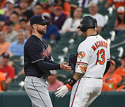 June 19, 2017 - Baltimore, MD, USA - Baltimore Orioles' Manny Machado, right, is tagged out by Cleveland Indians pitcher Corey Kluber, left, after a come-backer in the first inning on Monday, June 19, 2017 at Oriole Park at Camden Yards in Baltimore, Md. (Credit Image: © Kenneth K. Lam/TNS via ZUMA Wire)