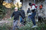November 8, 2016,  Breil-sur-Roya, French Alpes, France. Sylvain, 67 years, a retired school teacher, guides   Eritrean refugees who spent the night in the house of Eloïse, to his van in order to transport them over the mountains to a safe train station. By doing so Sylvain risks police arrests and a trial.<br /> <br /> 8 novembre 2016, Breil-sur-Roya, Alpes <br /> françaises, France. Sylvain, 67 ans, prof de math à la retraite, guide des réfugiés érythréens, qui ont passé la nuit dans la maison d'Eloïse, vers sa camionnette pour les transporter à travers la montagne jusqu'à une gare jugée sûre. Sylvain risque une  arrestation policières et un procès.